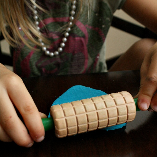 Making patterns with play dough tools