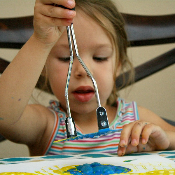 Toddler Painting without a Paintbrush