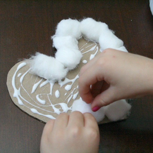 Glue cotton balls for puffy art