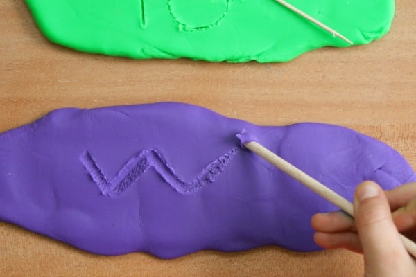 Practice writing spelling words in play dough