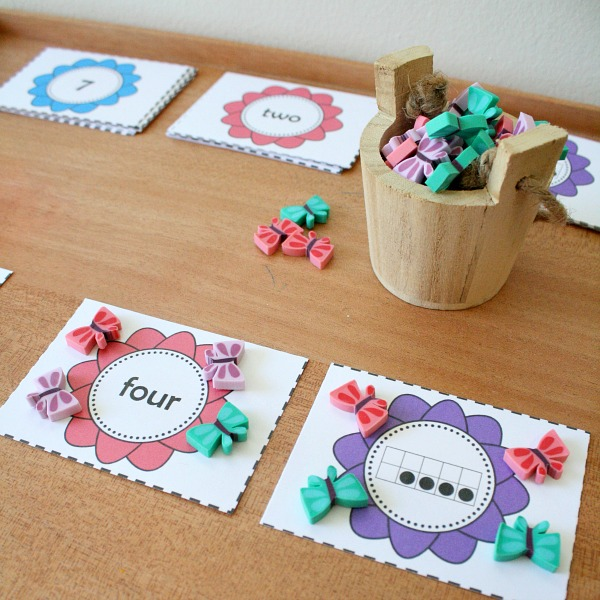 Use manipulatives and number cards to practice preschool number sense