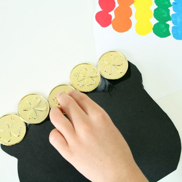 Adding gold to rainbow pot of gold craft for kids