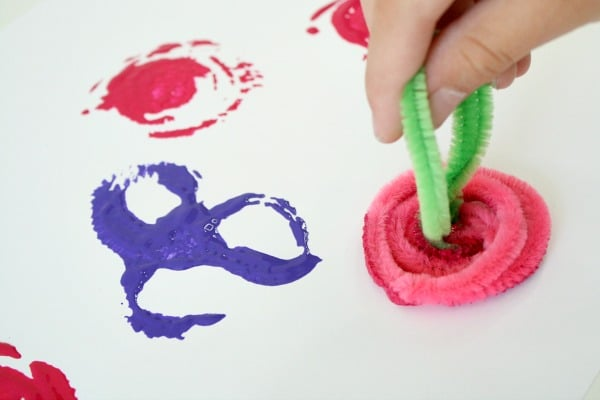 Stamping roses with pipe cleaners. Spring art for kids