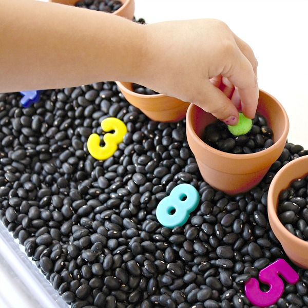 Planting seeds toddler play