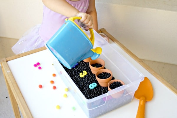 Watering seeds preschool pretend play