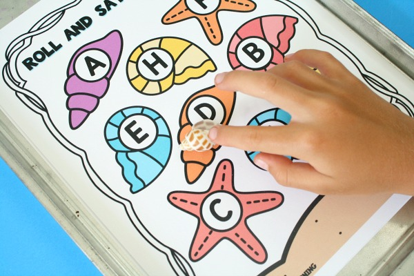 Playing Summer Alphabet Game for Preschool