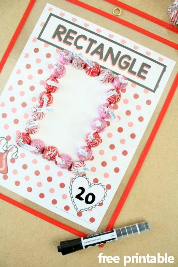Free Printable Preschool Valentine's Day Math Activity. Making shapes with chocolate kisses. #preschool #kindergarten #freebie #valentinesday
