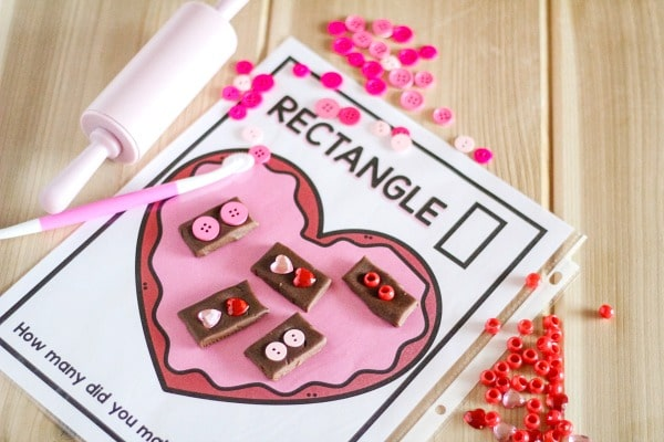 Valentine Play Dough Shape Mats - learn about shapes and practice fine motor skills with this free printable