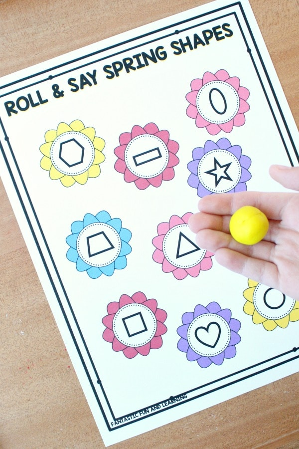 Free printable roll and say spring shapes math game