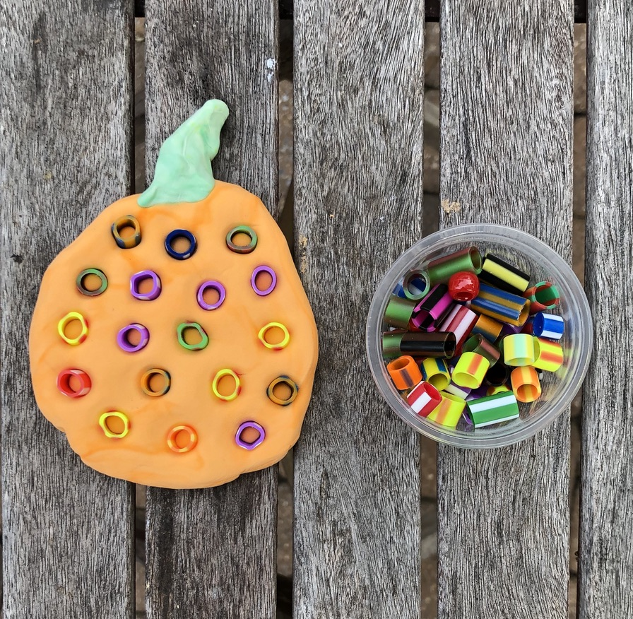 clay pumpkin art decorated with dots