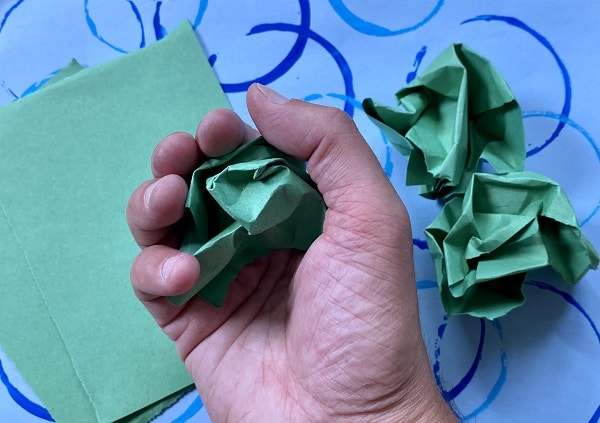 How to make a caterpillar craft-Crumple paper for fine motor work